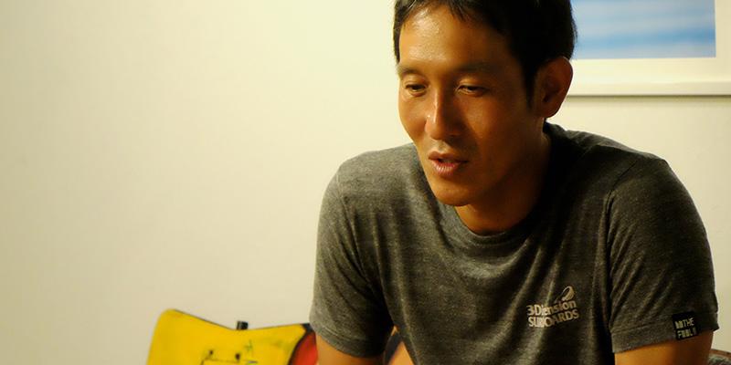 インタビューに答える田中岳宏さん